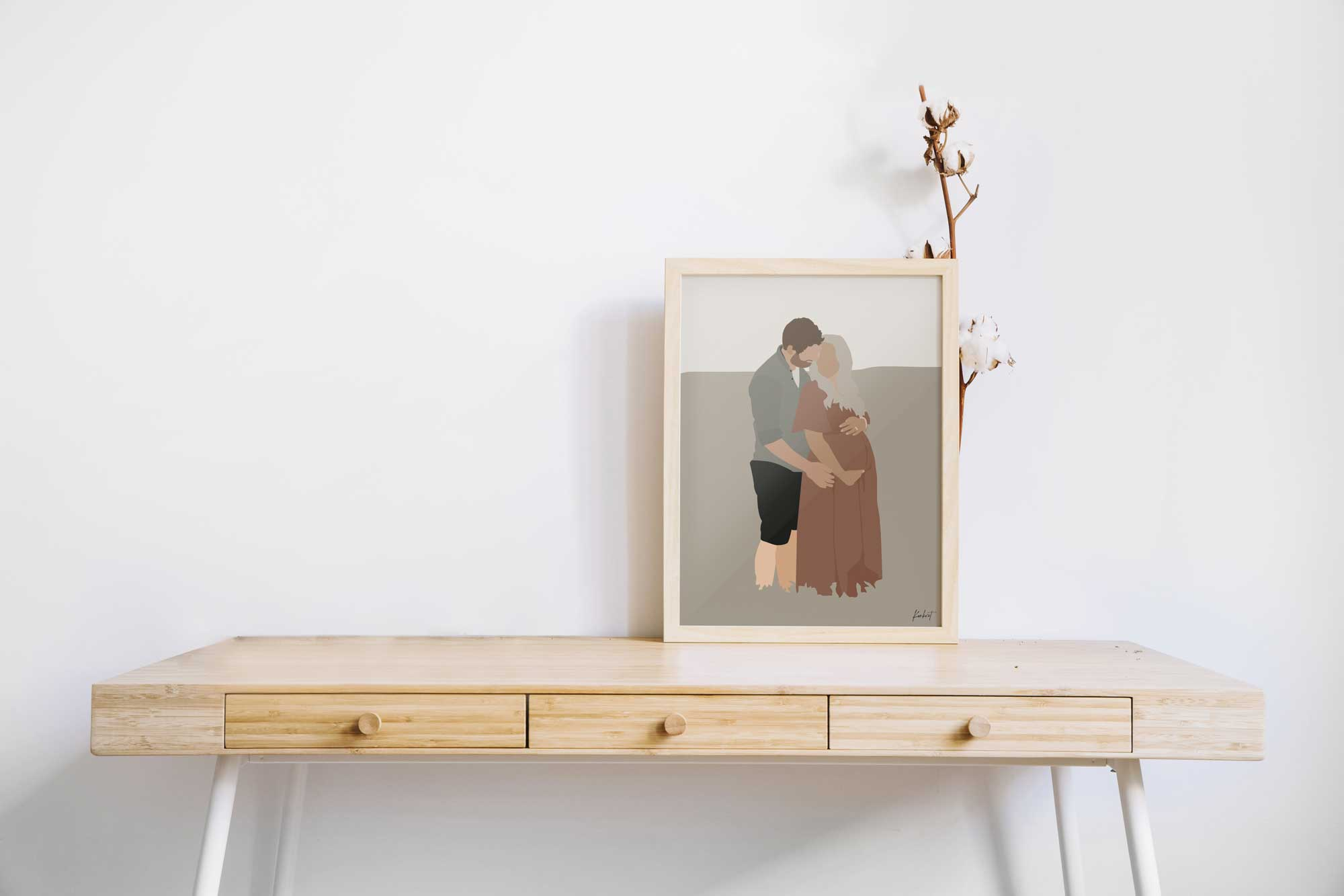 Gravid plakat i ramme på skrivebord